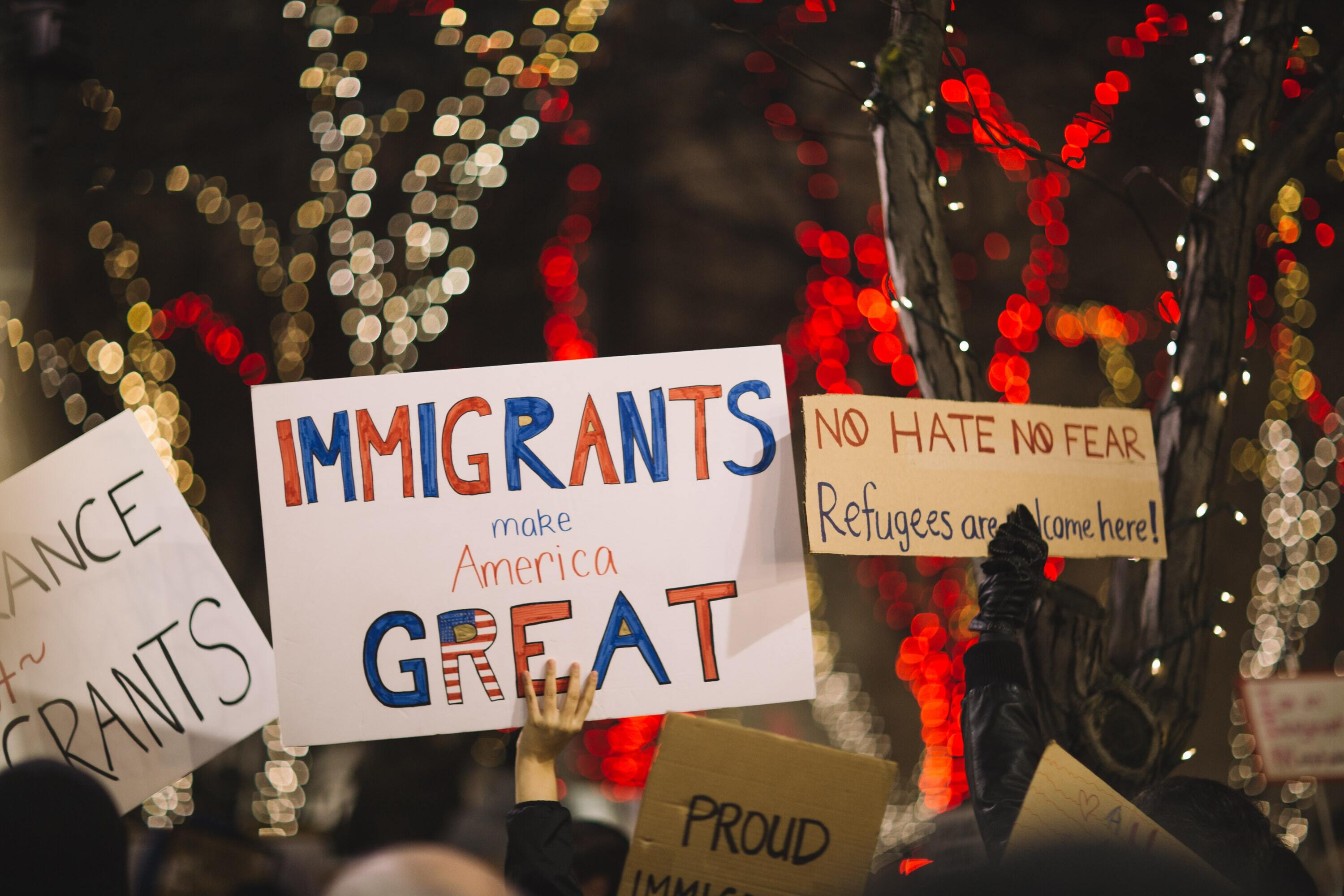 Sign at rally reads 'Immigrants Make America Great'