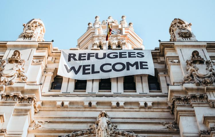 Refugees Welcome banner on building in Madrid, Spain
