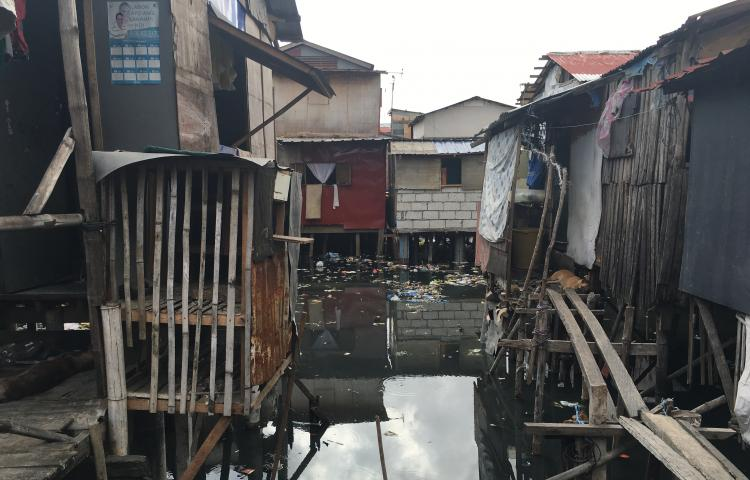 Homes sit on stilts above flood waters in the Philippines